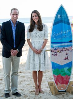 Prince William & Kate Middleton pose with a surfboard on the beach on Manly in Sydney,Australia on April 18,2014