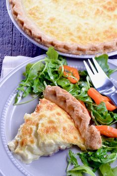 No Fail Quiche Lorraine plated to serve, an easy yet impressive recipe full of melty cheese, crisped bacon and ham mixed in a light creamy custard in a flaky buttery crust.