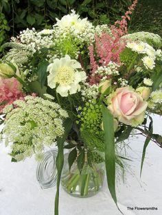 Flowers in jars for garden wedding www.theflowersmiths.co.uk