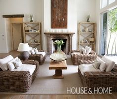 Eric Lamaze's Neutral Living Room | House & HomeGet balance in a long room by creating a symmetrical space. A bench serves as a narrow coffee table in this long space. Four wicker chairs surround the bench for a symmetrical look. The metal artwork, by artist Amber Denison, punctuates the warm white wall colour that is used throughout the house.