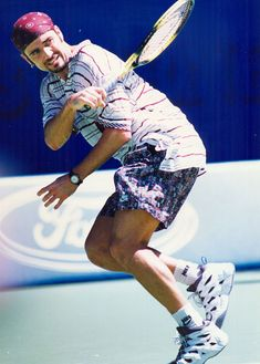 Agassi in his Nike Tennis clothes at the 1995 Australian Open.  He debuted this whole look, complete with the shaved head and bandanna, here after years with the infamous mullet.