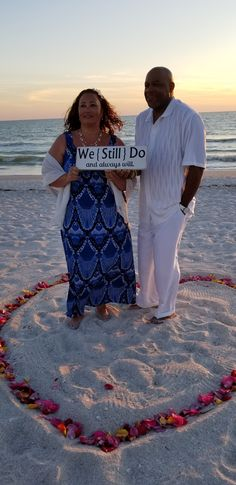 Surprise vow renewal ceremony. Sunset vow renewal ceremony. Fresh rose petal heart in sand.  Notary officiant.