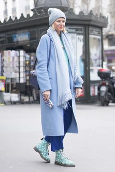 A blue coat, a cozy scarf, and a beanie.