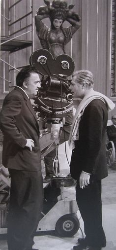"Federico Fellini With Marcello Mastroianni, on the set of ""8½""."