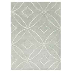 Hand-tufted New Zealand wool rug with a geometric motif.  Product: RugConstruction Material: New Zealand wool