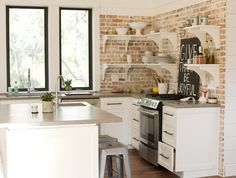 This could also be a great look - white shaker, black handles, and what looks like ceasarstone counters