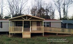 A Gable-Roof mobile home porch with a really nice design for an accessible wheel chair ramp by Ready Decks for Front Porch Ideas. #porch #mobilehome