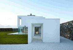 This family house is nestled against the stone remnants of an ancient stone cottage on the Welsh coast Houses In Ireland, Natural Stone Wall, Modern House Design, Modern Architecture, Interior And Exterior, Home And Family, New Homes, Cottage, House Styles