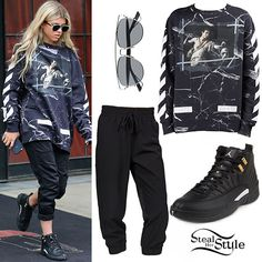 Sofia Richie stepped out in New York City on Tuesday wearing the Dior Technos Sunglasses ($560.00) in black and silver, the Off-White C/O Virgil Abloh Men's Black Marble Caravaggio Sweatshirt ($504.00), pants similar to these Women's Jockey Sport Flex Capri Jogger Pants ($24.99), and a pair of Nike Mens Air Jordan 12 Retro Black/White-Metallic Gold Leather Sneakers ($375.00+).