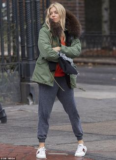 Tough time: Even Sienna Miller is familiar with the problem of finding a cab in New York C...