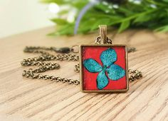 Check out this item in my Etsy shop https://www.etsy.com/uk/listing/269669809/pressed-flower-necklace-flower-necklace