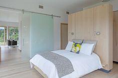 Shaw Island Prefab Passive House bedroom with sliding door.