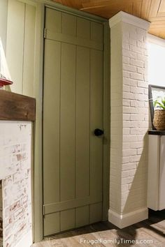 Flat to Fabulous: a dull door is transformed to a vintage tongue and groove look on a tiny budget! This hollow core door makeover is easy and affordable and looks lovely. Perfect for a cottage or farmhouse style room. Paired with a beautiful modern doorknob set for contrast the look is subtle yet interesting! #cottagedecor #farmhousedecor #diy #howto #homeprojects