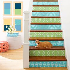 These stenciled risers are the cat's meow! #lowescreativeideas #stenciled_staircase #painted_staircase #staircase_diy #staircase_makeover #staircase_remodel #houselogic #foyer_makeover #staircase_ideas #foyer_ideas