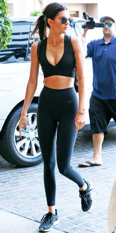 Kendall Jenner paired Nike leggings with a cutout bustier crop top, and laced up a pair of sneakers to create the gym-ready outfit.