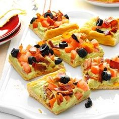 This cold appetizer pizza is great for family functions, potlucks, baby showers and more.   Guacamole Appetizer Squares Recipe from Taste of Home
