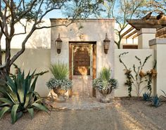 spanish colonial entry courtyard . features a cantera stone gate and hand-carved lion shield . photo: Mark Lohman
