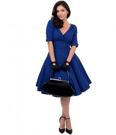 Let Delores get domestic with you, darling. A bewitching royal blue dress rich in 1950s vintage appeal that can only be...Price - $78.00-Sx64bevB