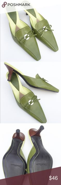 Cole Haan Green Kitten Heel Mules This beautiful pair of leather shoes is embellished with a leather bow, Cole Haan stamped metal ring, and contrasting stitching. There is a small blemish on the back of the left foot bed, otherwise excellent condition. The woodgrain 2 inch kitten heels have no marks at all. Cole Haan Shoes Mules & Clogs