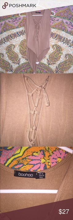 Beige Tie Up Bodysuit Beige Tie Up Bodysuit from Boohoo size 6. Perfect for going out! Boohoo Pants Jumpsuits & Rompers