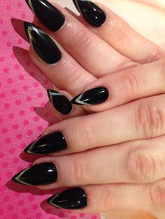Black Stiletto nails with a gold v