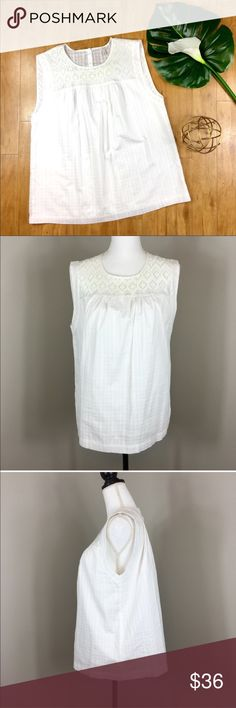 J.Crew White Embroidered Windowpane Top J.Crew White Embroidered Windowpane Top. Size 12. Approximate measurements flat laid are 26' long and 20' bust. Pre-owned condition with no major flaws. White fabric is in good condition as well. I have photos to show no stains under armholes.  Stock photo for fit not color. ❌I do not Trade 🙅🏻 Or model💲 Posh Transactions ONLY J. Crew Tops Blouses