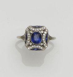 An Art Deco sapphire and diamond panel ring
