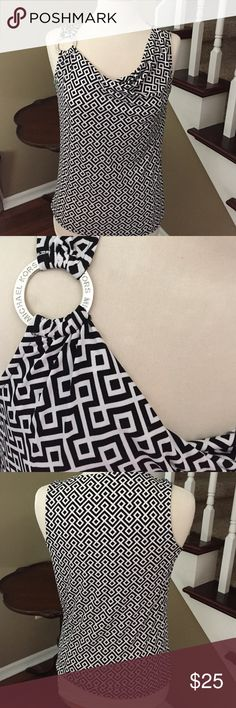 Michael Kors Top! Michael Kors black and white printed top with metal embellishment engraved with Michael Kors! Like new condition! 95% polyester 5% spandex. So great for summer or to layer! 24 inches long bust 17.5 inches MICHAEL Michael Kors Tops Tank Tops