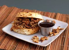 Nothing beats slow-cooked pulled pork for a party or gathering. The melt-in-your-mouth pork is shredded and served on sandwiches. It's simple and versatile, and your guests can build their sandwiches on toasted soft buns with this Carolina coleslaw and more barbecue sauce. Or serve the sandwiches with a creamy coleslaw or this kale and cabbage slaw. Barbecue Pulled Pork, Pulled Pork Recipes, Barbecue Recipes, Barbecue Sauce, Grilling Recipes, Best Crockpot Recipes, Slow Cooker Recipes, Crockpot Meals, Dinner Crockpot