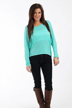"""A Little Sparkle Top, Mint $37.00  Is there anything better than a top that's soft AND sparkles? We love this lightweight piece, with raglan sleeves, a hi-lo hemline and sequined elbow patches. Wear it with jeans or a skirt for nicer occasions... you can't go wrong with this piece!   Fits true to size. Miranda is wearing a small.   From shoulder to hem:  Small - 22""""  Medium - 23""""  Large - 24"""""""