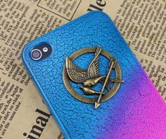 The Hunger Games  Mockingjay Logo Colorful  iPhone 4/4S case, Apple iPhone 4 Case, iPhone 4s Case, iPhone 4 Hard Case-Brass Hunger Games. $7.99, via Etsy.