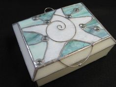 "Stained Glass Starfish Box by RenaissanceGlass on Etsy, $175.00.This beach themed box would make a wonderful keepsake for yourself or a thoughtful gift. It measures 6.5"" x 8.5"" x 3.5"" and has 3 compartments. The body of the box is a solid bone color and the starfish is white on a mottled blue/green background. It has a lift and a stopper on the back to keep the lid from tipping back."