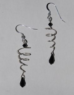 Wire spiral earrings with beads.