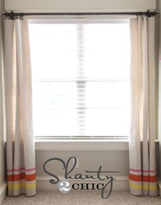 drop cloth drapes, painted stripes and DIY curtain rod. this girl is crafty.