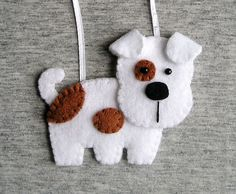 Handmade felt dog ornament dog terrier, felt ornament, cute hanging, white brown, christmas tree ornament Felt is a very soft, pleasing and environmentally friendly material. Felt ornament look great in any room. This ornament will serve you for a long time, you can take it away and hang again! It will be a perfect gift or decoration:) Decoration is made from felt and embroidered with embroidery. Every detail is hand cut by me. Measure approx. 10 cm x 7 cm (4 x 3) not including a hanging…