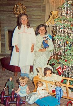 Christmas 1964 (I loved the icicles on the tree, and the doll on the floor is a Kissy Doll....)  Not my family but still a memory.