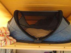 Image result for travel cot in campervan