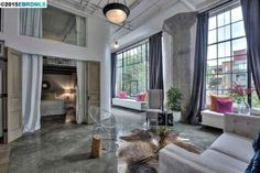 open plan spacious living room with polished concrete floor