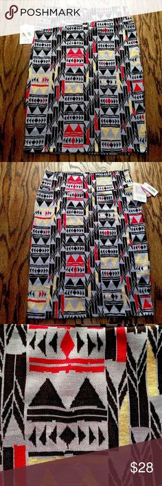 """LuLaRoe Cassie Pencil Skirt Geometric Tribal LulaRoe Cassie Pencil Skirt. Size Medium. Geometric Tribal Print. Lavender, Black, Red, Tan. Polyester/Spandex. Machine wash. New with tags.  Waistband: 14.5"""" Length: 24""""  Inventory #: CL2 LuLaRoe Skirts Pencil"""