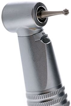 A dental handpiece with a carbide bur