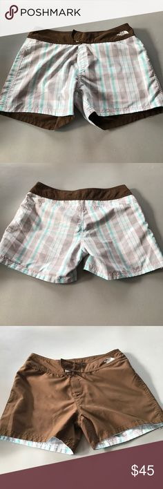 The North Face reversible shorts size 6 He North Face reversible shorts size 6. Worn once. Perfect condition. One side is blue white and brown plaid. The other side is brown. Perfect for all weather conditions. The North Face Shorts