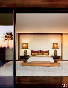 """""""I wanted to be able to curl up in it,"""" she says of the master bedroom. Shadley designed the platform bed, which has a motorized television lift topped with Rogers & Goffigon fabric. Of the shag rug, he says, """"It's wool and silk and very lush."""""""