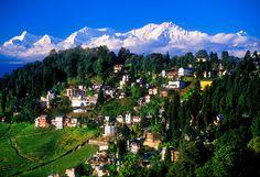 View of Darjeeling with Himalayas in background (Kanchenjunga, third highest peak in the world), Darjeeling, West Bengal, India Adventure Travel Companies, Adventure Tours, Tourist Places, Places To Travel, Travel Destinations, Tibet, Amazing India, Romantic Honeymoon, Darjeeling