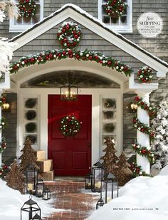 Pottery Barn | welcoming front entrance keeping with red and white theme | traditional outdoor decor for Christmas