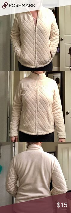 Soft White Zip Up Soft white zip up sweater with quilted pattern on front. Two front pockets. Tops Sweatshirts & Hoodies