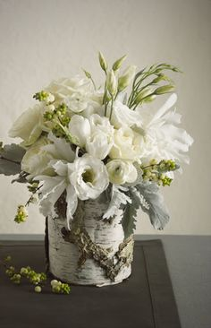 birch vase with dusty miller, snowberry branches, lisianthus, tulips, ranunculus,  and then something i can't identify