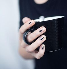 black triangle nails