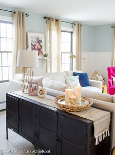 If your couch is floating in the middle of the floor, try adding a sofa table behind it. Not only does it help anchor the couch from looking lost in the middle of the floor, it also creates a hard surface for lighting and decorative home decor.