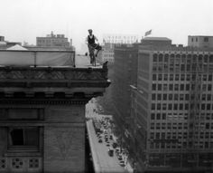 A bicycle stunt on top of the Los Angeles Athletic Club located at 431 West 7th Street. (LAPL)  Bizarre Los Angeles.