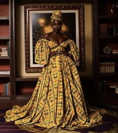 Bold and stylish Ankara statement gowns for weddings <br> Claude Kameni is the creative director of Lavie by CK Kameni is a Cameroonian Fashion Designer based in New York African Formal Dress, African Print Wedding Dress, African Prom Dresses, African Attire, African Fashion Dresses, African Dress, Ghana Wedding Dress, African Style, African Inspired Fashion